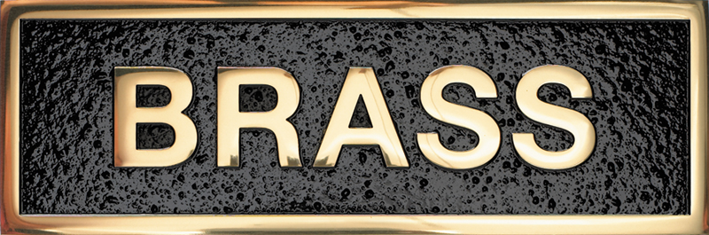 a photo of a polished finish brass plaque