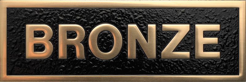 a photo of a polished finish bronze plaque
