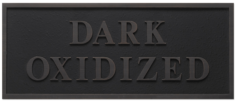 a photo of a dark oxidized finish for a bronze plaque