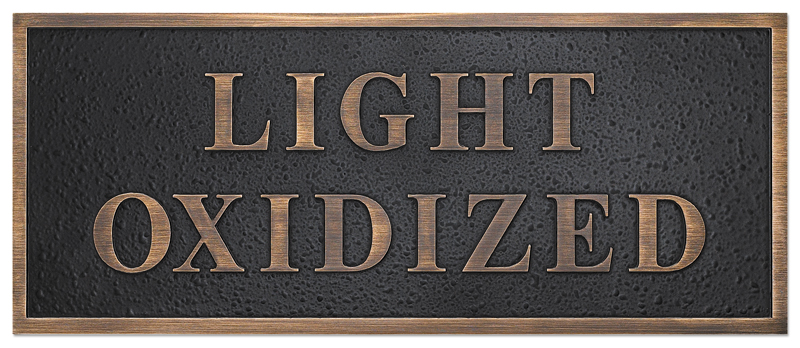 a photo of a light oxidized finish for a bronze plaque